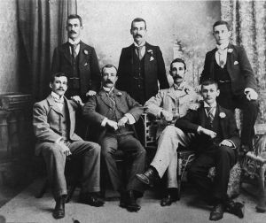 713px-StateLibQld_2_167751_Group_of_men_wearing_three-piece_suits,_posing_for_a_portrait,_1890-1900